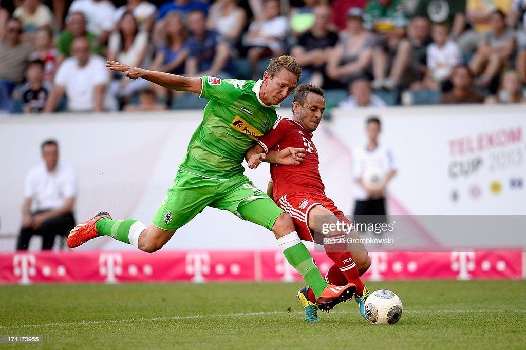 Luuk de Jong of Borussia Moenchengladbach and Rafinha of FC Bayern Muenchen battle for the ball during the Telekom 2013 Cup final between FC Bayern Muenchen and Borussia Moenchengladbach on July 21, 2013 in Moenchengladbach, Germany.