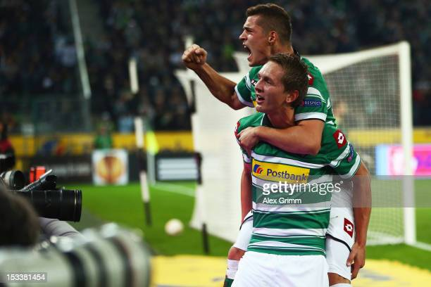 Luuk de Jong of Moenchengladbach celebrates his team's first goal with team mate Granit Xhaka during the UEFA Europa League group C match between...