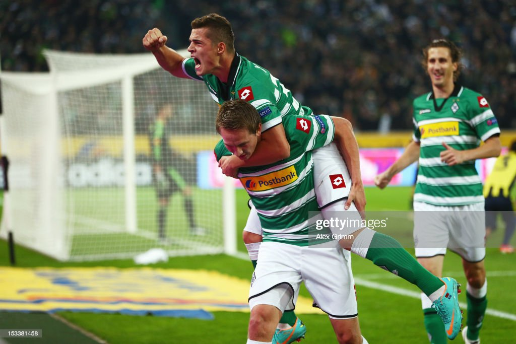 Luuk de Jong (front) of Moenchengladbach celebrates his team's first goal with team mates <a gi-track='captionPersonalityLinkClicked' href=/galleries/search?phrase=Granit+Xhaka&family=editorial&specificpeople=5848141 ng-click='$event.stopPropagation()'>Granit Xhaka</a> and <a gi-track='captionPersonalityLinkClicked' href=/galleries/search?phrase=Roel+Brouwers&family=editorial&specificpeople=711197 ng-click='$event.stopPropagation()'>Roel Brouwers</a> during the UEFA Europa League group C match between Borussia Moenchengladbach and Fenerbahce SK at Borussia-Park on October 4, 2012 in Moenchengladbach, Germany.