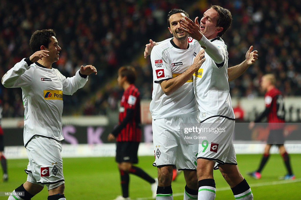 Luuk de Jong of Moenchengladbach celebrates his team's first goal with team mates Martin Stranzl and Amin Younes during the Bundesliga match between...