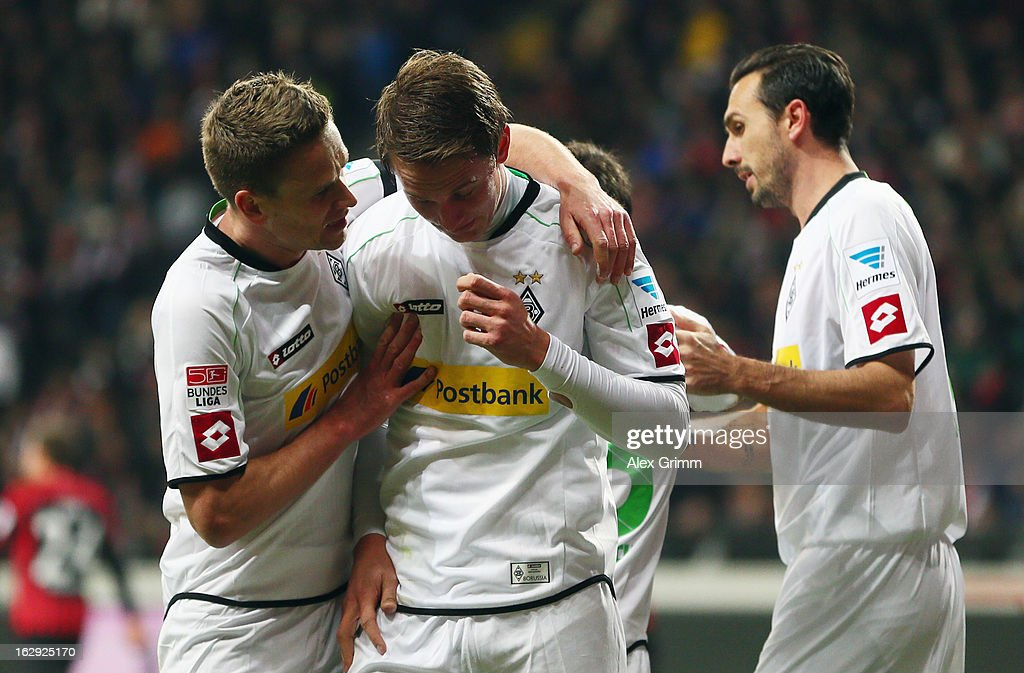 Luuk de Jong (C) of Moenchengladbach celebrates his team's first goal with team mates <a gi-track='captionPersonalityLinkClicked' href=/galleries/search?phrase=Filip+Daems&family=editorial&specificpeople=649346 ng-click='$event.stopPropagation()'>Filip Daems</a> (L) and <a gi-track='captionPersonalityLinkClicked' href=/galleries/search?phrase=Martin+Stranzl&family=editorial&specificpeople=674140 ng-click='$event.stopPropagation()'>Martin Stranzl</a> during the Bundesliga match between Eintracht Frankfurt and Borussia Moenchengladbach at Commerzbank-Arena on March 1, 2013 in Frankfurt am Main, Germany.