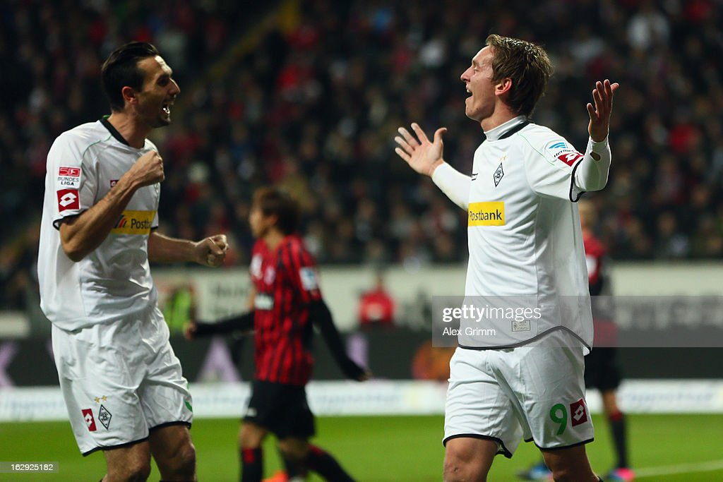 Luuk de Jong (R) of Moenchengladbach celebrates his team's first goal with team mate <a gi-track='captionPersonalityLinkClicked' href=/galleries/search?phrase=Martin+Stranzl&family=editorial&specificpeople=674140 ng-click='$event.stopPropagation()'>Martin Stranzl</a> during the Bundesliga match between Eintracht Frankfurt and Borussia Moenchengladbach at Commerzbank-Arena on March 1, 2013 in Frankfurt am Main, Germany.