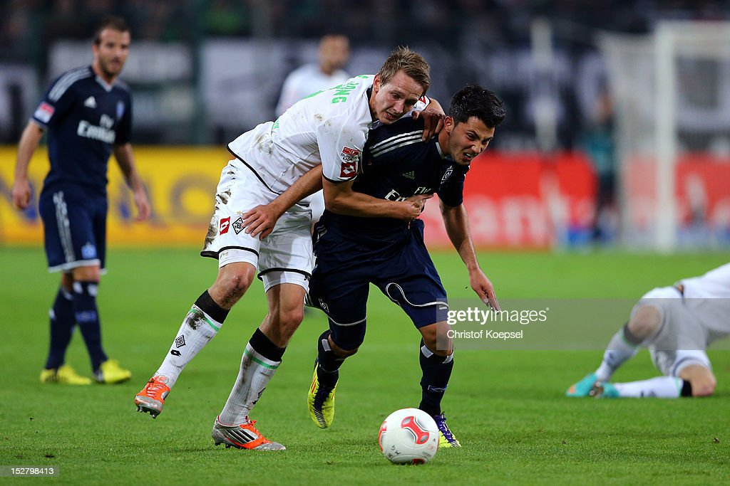 Luuk de Jong of Moenchengladbach challenges Tolgay Arslan of Hamburg during the Bundesliga match between Borussia Moenchengladbach and Hamburger SV at Borussia Park Stadium on September 26, 2012 in Moenchengladbach, Germany.