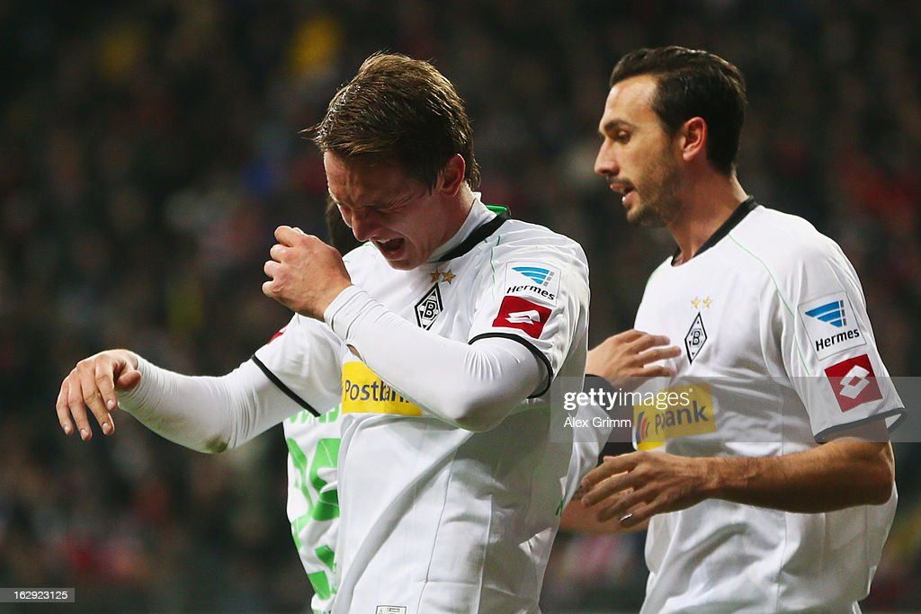 Luuk de Jong (front) of Moenchengladbach reacts after scoring his team's first goal during the Bundesliga match between Eintracht Frankfurt and Borussia Moenchengladbach at Commerzbank-Arena on March 1, 2013 in Frankfurt am Main, Germany.