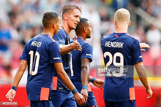 Luuk de Jong of PSV celebrates scoring his teams third goal of the game with team mates during the Johan Cruijff Shield match between FC Groningen...