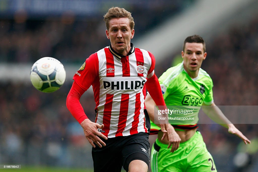 Luuk de Jong of PSV gets past the tackle from Nick Viergever of Ajax during the Eredivisie match between PSV Eindhoven and Ajax Amsterdam held at Philips Stadium on March 20, 2016 in Eindhoven, Netherlands.