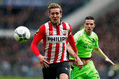 Luuk de Jong of PSV gets past the tackle from Nick Viergever of Ajax during the Eredivisie match between PSV Eindhoven and Ajax Amsterdam held at...