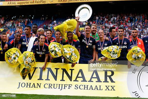 Luuk de Jong of PSV holds the trophy and leads celebrations after winning the Johan Cruijff Shield match between FC Groningen and PSV Eindhoven on...