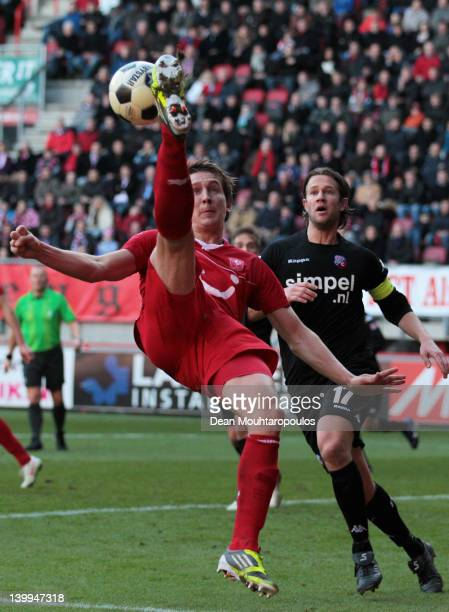 Luuk de Jong of Twente does an overhead kick in front of Alje Schut of Utrecht during the Eredivisie match between FC Twente and FC Utrecht at De...