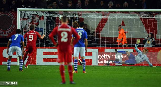 Luuk de Jong of Twente scores his teams first goal during the UEFA Europa League Round of 16 first leg match between FC Twente and FC Schalke 04 on...