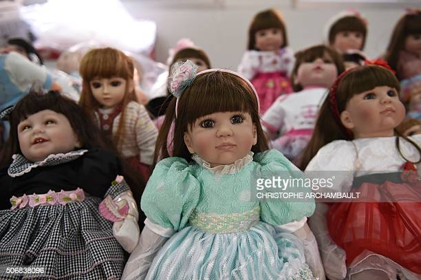 'Luuk thep' dolls are displayed at the Economic Crime Suppression Division after more than a hundred of them were seized in separate raids in Bangkok...