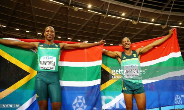 Luvo Manyonga of South Africa and Ruswahl Samaai of South Africa waves their National flags following the Men's Long Jump competion during day two of...