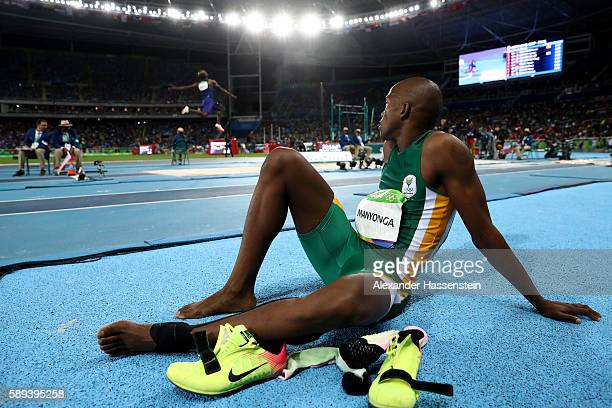Luvo Manyonga of South Africa watches as Jeff Henderson of the United States competes in the Men's Long Jump Final on Day 8 of the Rio 2016 Olympic...