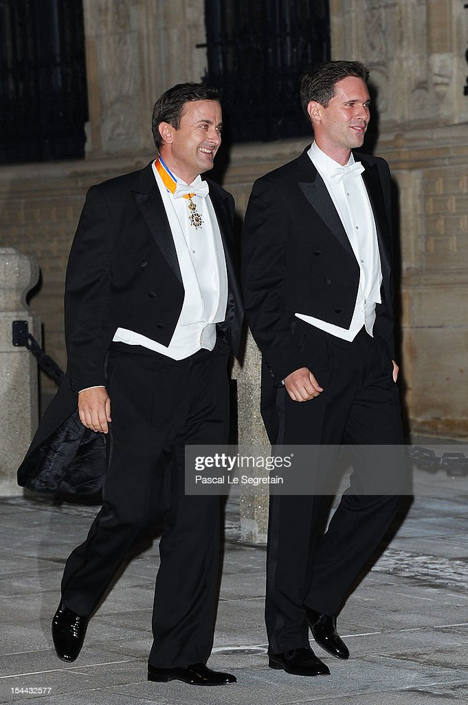 Luxembourg City's Mayor Xavier Bettel (L) and partner attend the Gala dinner for the wedding of Prince Guillaume Of Luxembourg and Stephanie de Lannoy at the Grand-ducal Palace on October 19, 2012 in Luxembourg, Luxembourg. The 30-year-old hereditary Grand Duke of Luxembourg is the last hereditary Prince in Europe to get married, marrying his 28-year old Belgian Countess bride in a lavish 2-day ceremony.