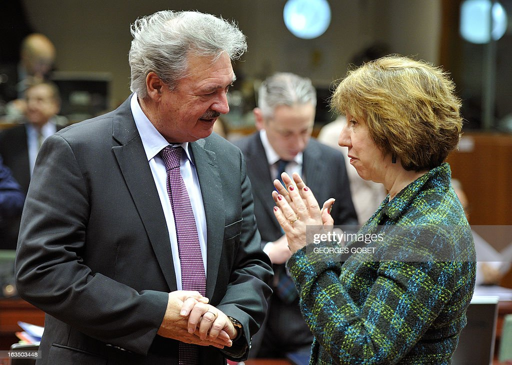 Luxembourg Foreign Affairs Minister Jean Asselborn and High Representative of the European Union for Foreign Affairs and Security Policy Catherine Ashton (R) talk prior an Foreign Affairs Council on March 11, 2013 at the EU Headquarters in Brussels.