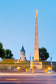 Luxembourg, Luxembourg City, Monument Gelle Fra at the Place de la Constitution, Tower of Museé de la Banque in the background, morning light