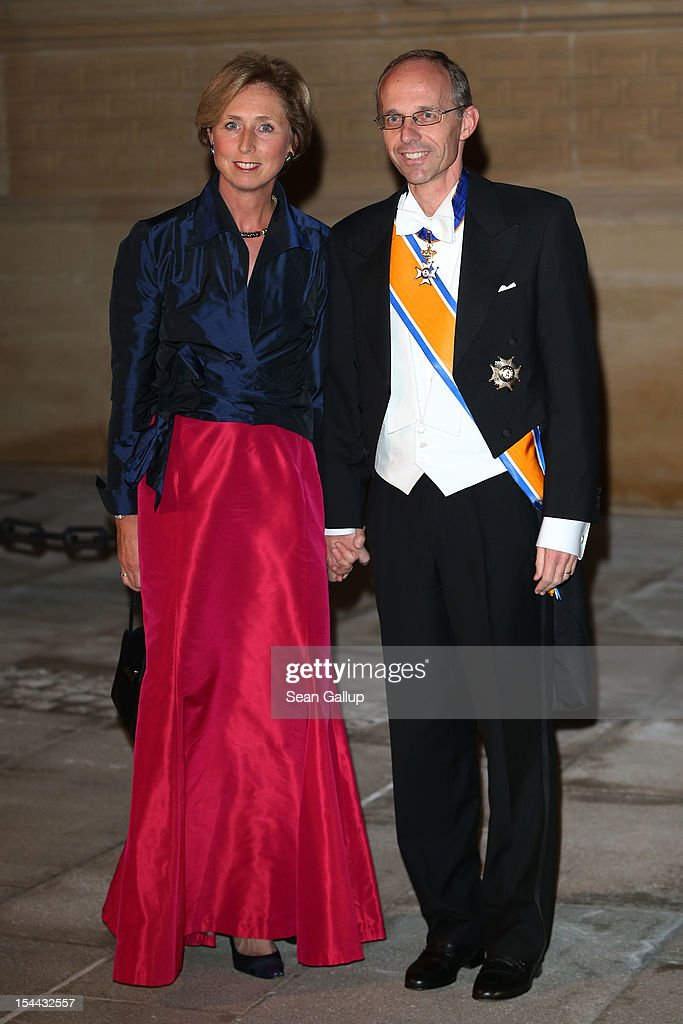 Luxembourg Minister for Finances, <a gi-track='captionPersonalityLinkClicked' href=/galleries/search?phrase=Luc+Frieden&family=editorial&specificpeople=651276 ng-click='$event.stopPropagation()'>Luc Frieden</a> (R) and wife attend the Gala dinner for the wedding of Prince Guillaume Of Luxembourg and Stephanie de Lannoy at the Grand-ducal Palace on October 19, 2012 in Luxembourg, Luxembourg. The 30-year-old hereditary Grand Duke of Luxembourg is the last hereditary Prince in Europe to get married, marrying his 28-year old Belgian Countess bride in a lavish 2-day ceremony.