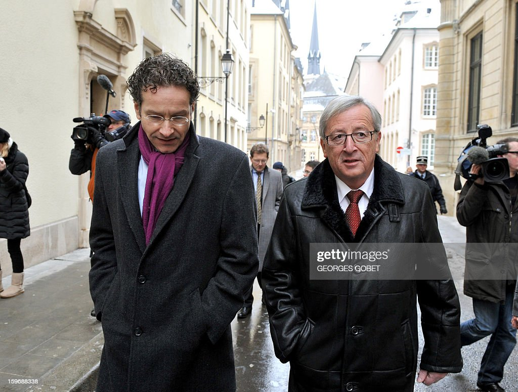 Luxembourg Prime Minister and Eurogroup president Jean-Claude Juncker (R) walks with Dutch Finance Minister Jeroen Dijsselbloem (L) before a lunch following a short meeting in his office at the Hotel de Bourgogne in Luxembourg on January 18, 2013. Juncker and his probable successor as head of the Eurogroup are due to review the financial and economic situation in the Euro zone and the preparation of the next meeting of the Eurogroup, to be held on January 21 in Brussels.