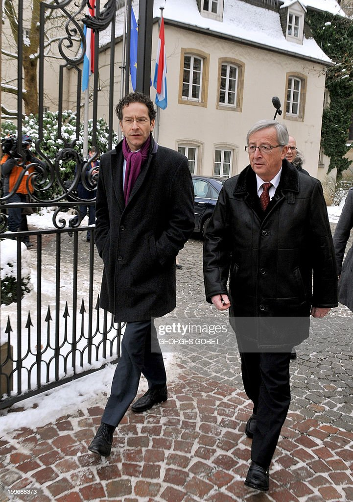 Luxembourg Prime Minister and Eurogroup president Jean-Claude Juncker (R) walks with Dutch Finance Minister Jeroen Dijsselbloem (L) before a lunch following a short meeting in his office at the Hotel de Bourgogne in Luxembourg on January 18, 2013. Juncker and his probable successor as head of the Eurogroup are due to review the financial and economic situation in the Euro zone and the preparation of the next meeting of the Eurogroup, to be held on January 21 in Brussels. AFP PHOTO / GEORGES GOBET