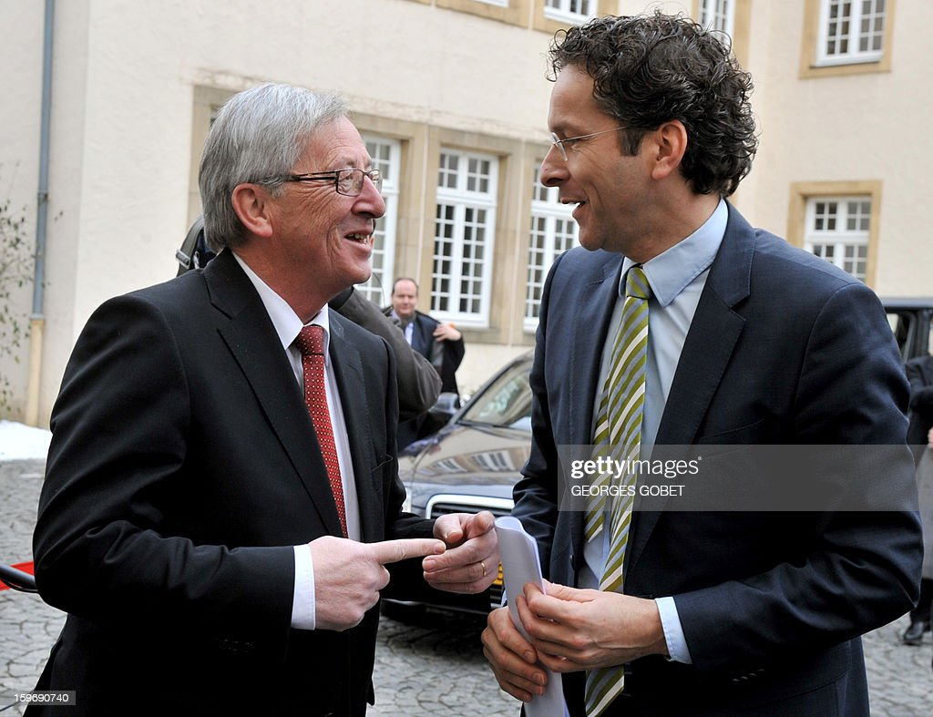 Luxembourg Prime Minister and Eurogroup president Jean-Claude Juncker (L) welcomes Dutch Finance Minister Jeroen Dijsselbloem at the Hotel de Bourgogne before a meeting in Luxembourg on January 18, 2013. Juncker and his probable successor as head of the Eurogroup are due to review the financial and economic situation in the Euro zone and the preparation of the next meeting of the Eurogroup, to be held on January 21 in Brussels. AFP PHOTO / GEORGES GOBET