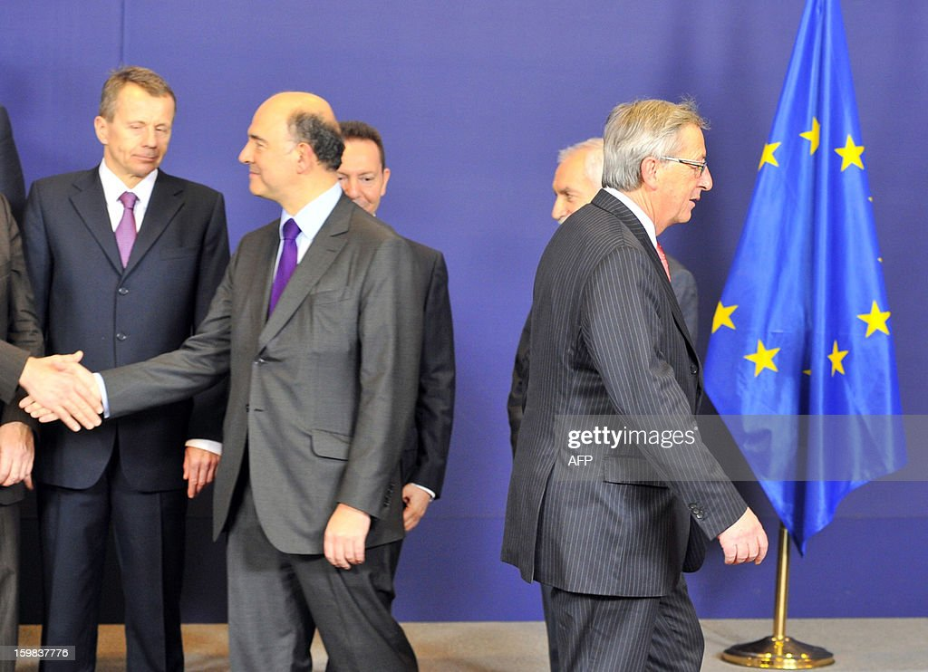 Luxembourg Prime Minister and Eurogroup president Jean-Claude Juncker leaves after the family picture prior to an Eurogroup meeting on January 21, 2013 at the EU Headquarters in Brussels.Juncker chairs his last meeting of Eurogroup finance ministers on Monday after years battling the debt crisis, before handing over to Dutch Finance Minister Jeroen Dijsselbloem amid relative eurozone calm.