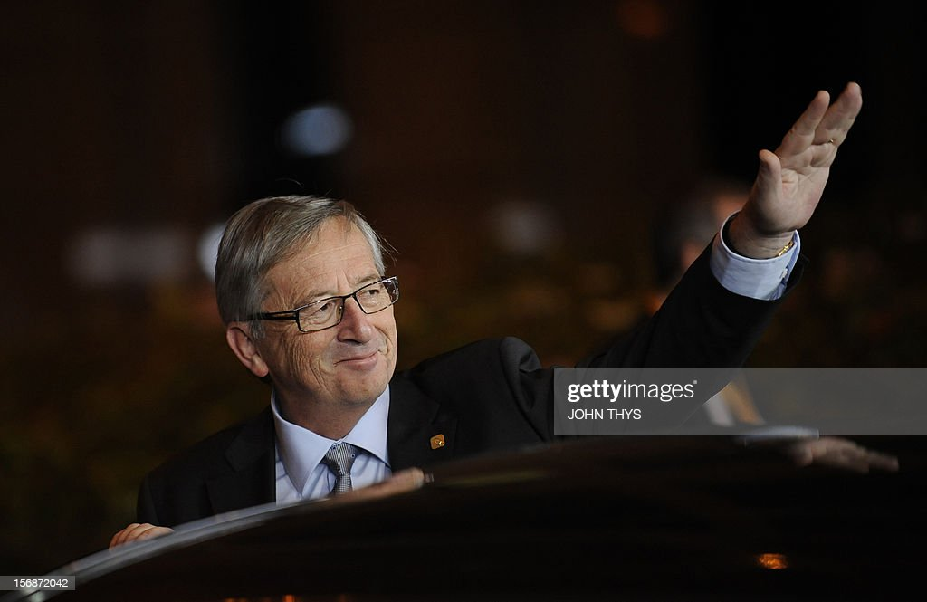 Luxembourg Prime Minister Jean-Claude Juncker gestures as he leaves the EU Headquarters on November 23, 2012 in Brussels, during a two-day European Union leaders summit called to agree a hotly-contested trillion-euro budget through 2020. European Union officials were scrambling to find an all but impossible compromise on the 2014-2020 budget that could successfully move richer nations looking for cutbacks closer to poorer ones who look to Brussels to prop up hard-hit industries and regions. AFP PHOTO / JOHN THYS