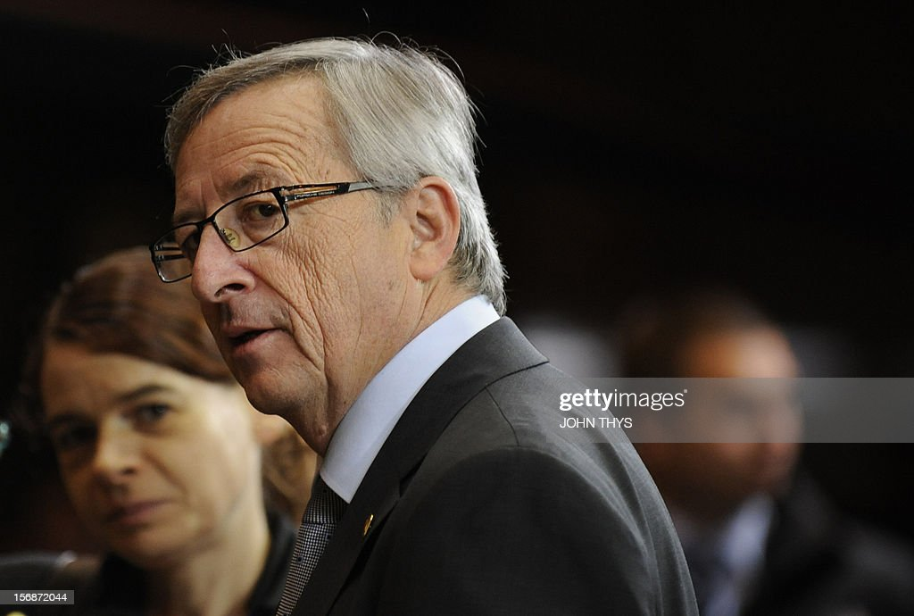 Luxembourg Prime Minister Jean-Claude Juncker leaves the EU Headquarters on November 23, 2012 in Brussels, during a two-day European Union leaders summit called to agree a hotly-contested trillion-euro budget through 2020. European Union officials were scrambling to find an all but impossible compromise on the 2014-2020 budget that could successfully move richer nations looking for cutbacks closer to poorer ones who look to Brussels to prop up hard-hit industries and regions. AFP PHOTO / JOHN THYS