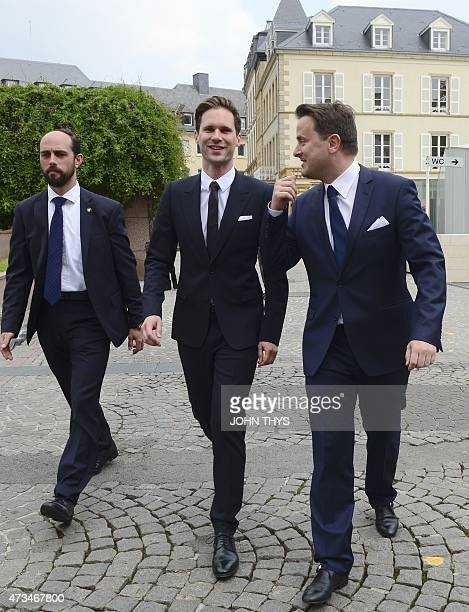 Luxembourg Prime Minister Xavier Bettel and his companion Belgian architect Gauthier Destenay arrive at City Hall for their wedding in Luxembourg on...