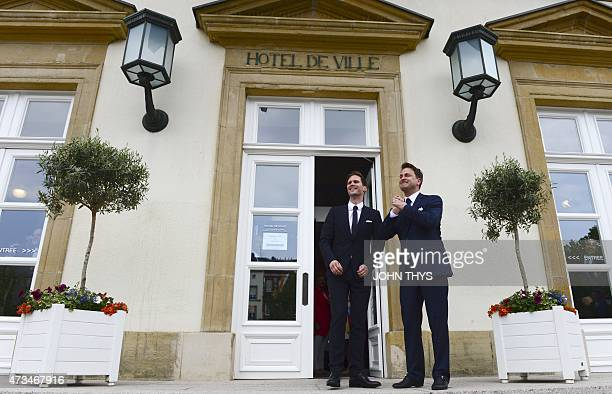 Luxembourg Prime Minister Xavier Bettel and his companion Belgian architect Gauthier Destenay stand outside City Hall during their wedding in...