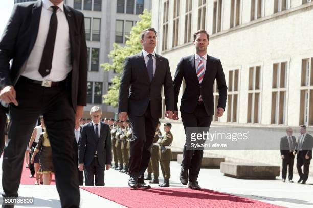 Luxembourg Prime Minister Xavier Bettel and his husband arrive for the Te Deum for National Day at Notre Dame du Luxembourg cathedral on June 23 2017...