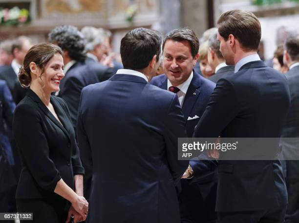 Luxembourg Prime Minister Xavier Bettel and his husband Gauthier Destenay speak with Greece Prime Minister Alexis Tsipras back to camera and his wife...