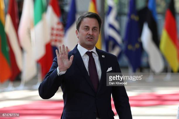 Luxembourg Prime Minister Xavier Bettel arrives to speak to the media at the Council of the European Union ahead of an EU Council meeting on April 29...