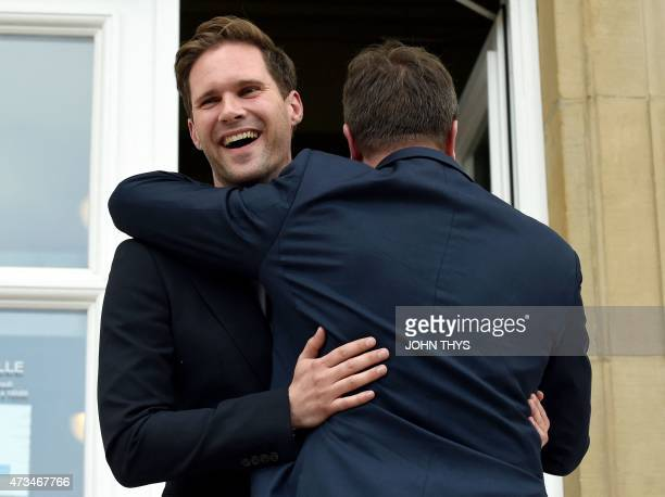 Luxembourg Prime Minister Xavier Bettel hugs his companion Belgian architect Gauthier Destenay outside City Hall during their wedding in Luxembourg...