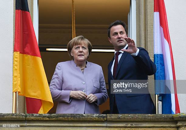 Luxembourg Prime Minister Xavier Bettel speaks with German Chancellor Angela Merkel during her visit to Luxembourg on January 12 2017 / AFP / JOHN...