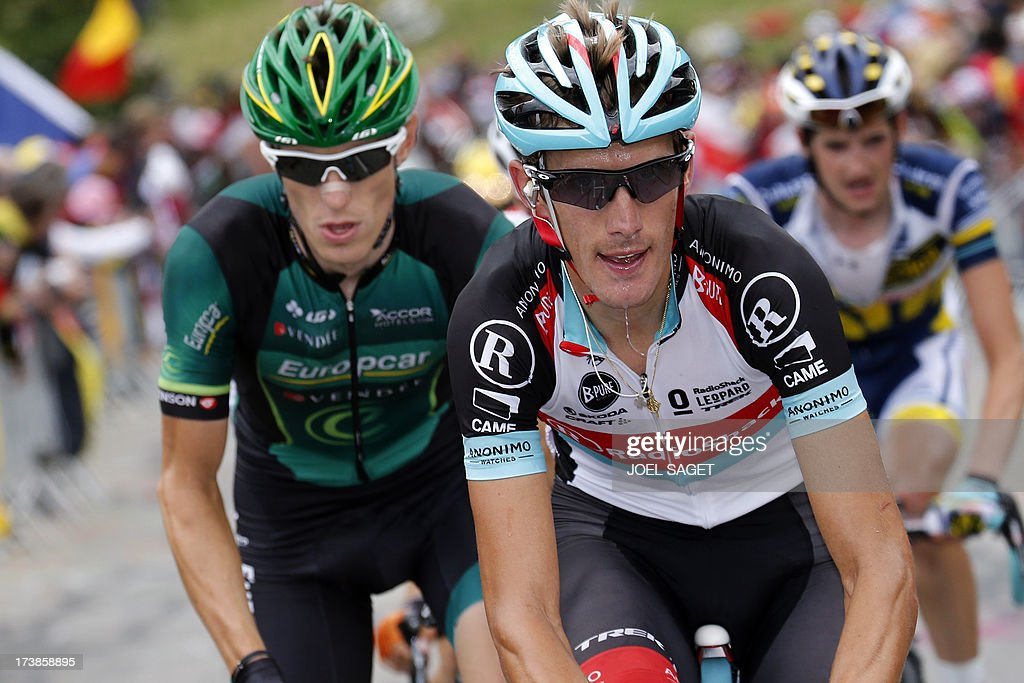 Luxembourg's Andy Schleck (C) and France's Pierre Rolland (L) ride during the 172.5 km eighteenth stage of the 100th edition of the Tour de France cycling race on July 18, 2013 between Gap and Alpe-d'Huez, French Alps. AFP PHOTO / JOEL SAGET