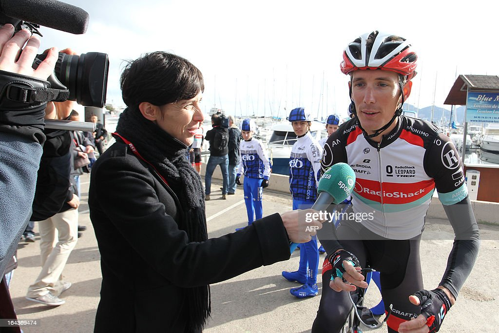 Luxembourg's Andy Schleck answers journalist's questions prior to take the start of the 82th Criterium International cycling race's first stage in Porto Vecchio on March 23, 2013.