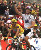 Luxembourg's Andy Schleck crosses the finish line ahead of Spaniard Alberto Contador at the end of stage 17 of the Tour de France on July 22 2010 in...