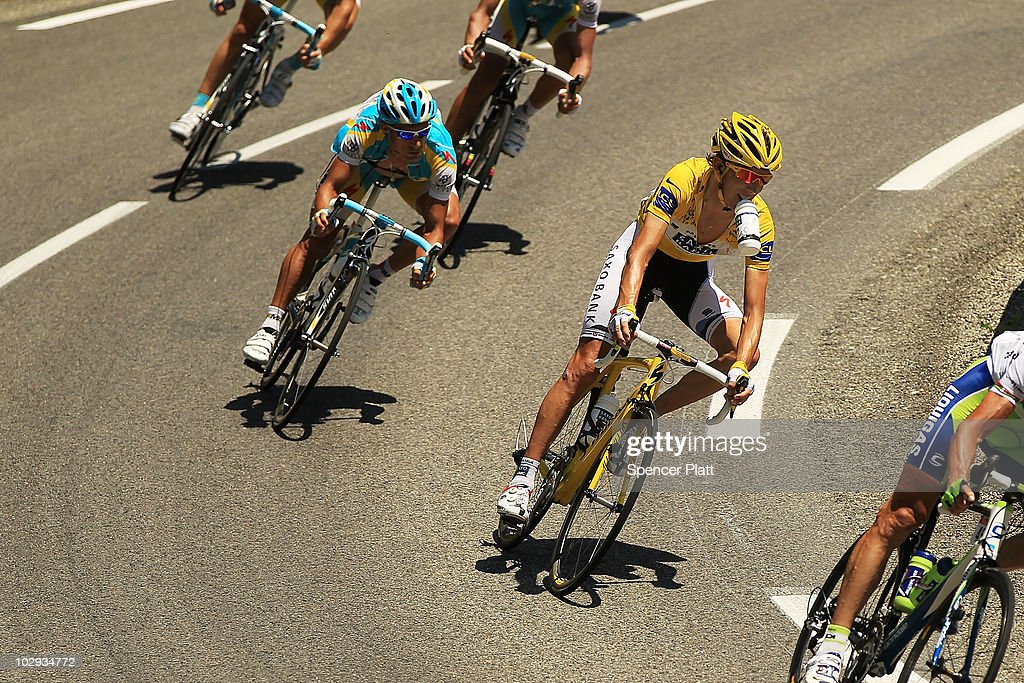 Luxembourg's <a gi-track='captionPersonalityLinkClicked' href=/galleries/search?phrase=Andy+Schleck&family=editorial&specificpeople=768445 ng-click='$event.stopPropagation()'>Andy Schleck</a>, in the yellow jersey, rides with the main group along stage 12 of the Tour de France July 16, 2010 in Mende, France. The stage, which started in Bourg-de-Peage, included the La Croix Neuve pass which is nearly 1.2 miles in length with an average gradient of more than 10%. Joaquin Rodriguez of Spain won the stage while Schleck of Saxo Bank continued to hold onto the yellow jersey. The iconic bicycle race will include a total of 20 stages and will cover 3,642km before concluding in Paris on July 25.
