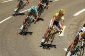 Luxembourg's Andy Schleck in the yellow jersey rides with the main group along stage 12 of the Tour de France July 16 2010 in Mende France The stage...