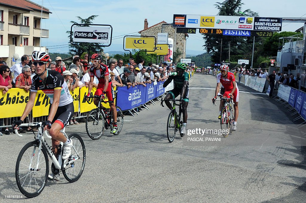 Luxembourg's Andy Schleck (L) is pictured after crossing the finish line at the end of the second stage of the 160 km of the 64rd edition of the Dauphine Criterium cycling race run between Lamastre and Saint-Felicien, Southeastern France, on June 05, 2012.
