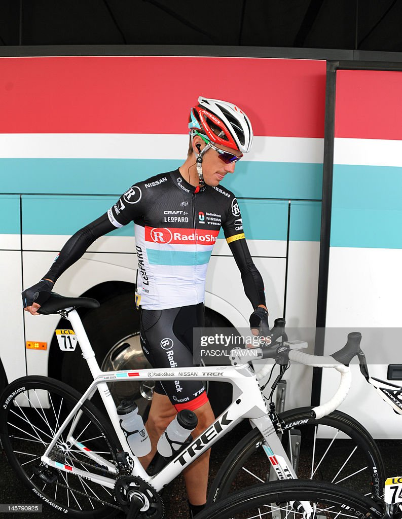 Luxembourg's Andy Schleck is pictured on June 06 , 2012 as the walks to the signature ceremony prior to the start of the 167 km of the 64rd edition of the Dauphine Criterium cycling race between Givors and La Clayette, Southeastern France.