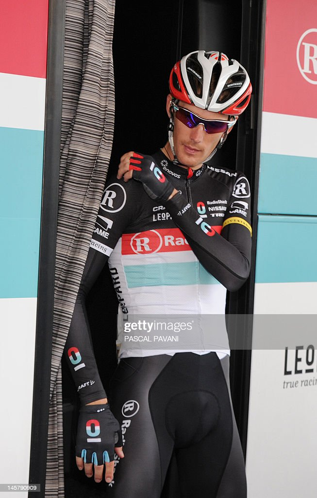 Luxembourg's Andy Schleck leaves the team bus on June 06 , 2012 to go the signature ceremony prior to the start of the 167 km of the 64rd edition of the Dauphine Criterium cycling race between Givors and La Clayette, Southeastern France.