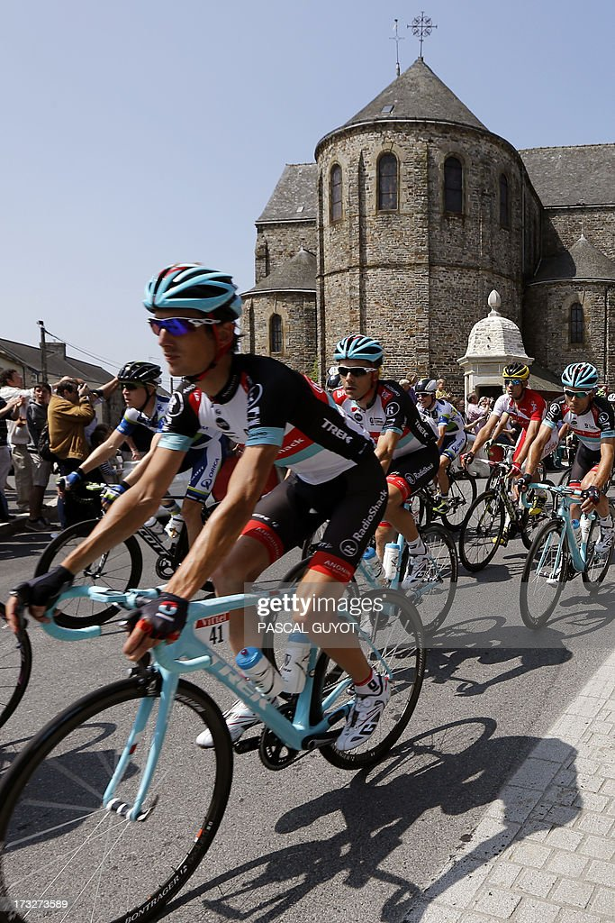 Luxembourg's Andy Schleck (L) rides in the pack during the 218 km twelfth stage of the 100th edition of the Tour de France cycling race on July 11, 2013 between Fougères and Tours, northwestern France.