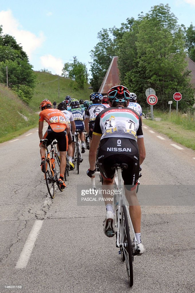 Luxembourg's Andy Schleck (foreground) rides on June 9, 2012 in the sixth stage of the 64rd edition of the Dauphine Criterium cycling race between Saint-Aban-Leysse and Morzine, French Alps.