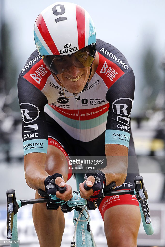Luxembourg's Andy Schleck sprints before the finish line at the end of the 32 km individual time-trial and seventeenth stage of the 100th edition of the Tour de France cycling race on July 17, 2013 between Embrun and Chorges, southeastern France.