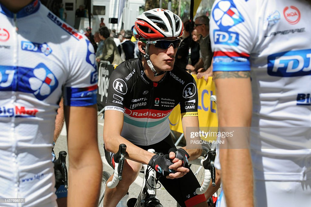 Luxembourg's Andy Schleck waits for the start of the second stage of the 160 km of the 64rd edition of the Dauphine Criterium cycling race run between Lamastre and Saint-Felicien, Southeastern France, on June 05, 2012.