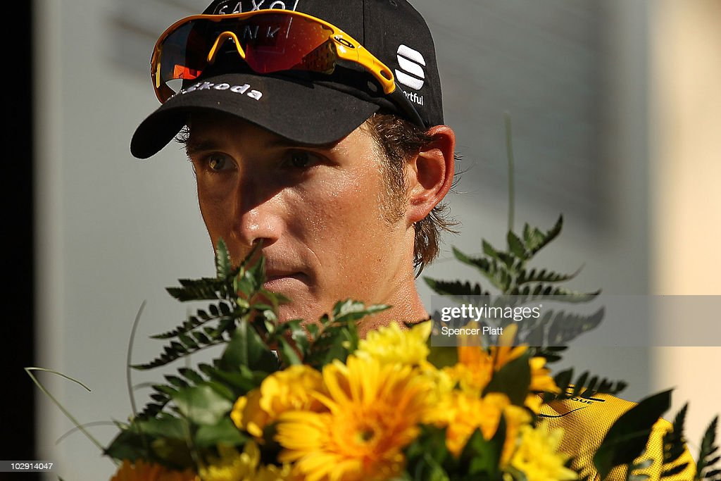 Luxembourg's <a gi-track='captionPersonalityLinkClicked' href=/galleries/search?phrase=Andy+Schleck&family=editorial&specificpeople=768445 ng-click='$event.stopPropagation()'>Andy Schleck</a>, wearing the race leaders yellow jersey, stands on the podium after stage 11 of the Tour de France July 15, 2010 in Bourg-les-Valence, France. The 184.5-km course featured only one moderate climb and ended as expected in a sprint. Schleck of team Saxo Bank holds a slim lead of Alberto Contador of team Astana. The iconic bicycle race will include a total of 20 stages and will cover 3,642km before concluding in Paris on July 25.
