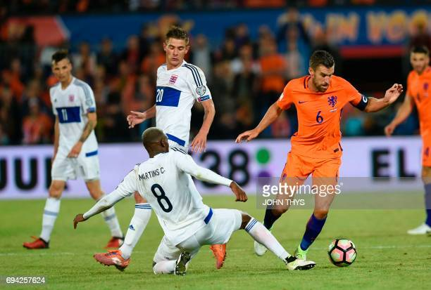 Luxembourg's Christophe Martins vies with Dutch's Kevin Strootman during the FIFA World Cup 2018 qualification football match between Netherlands and...