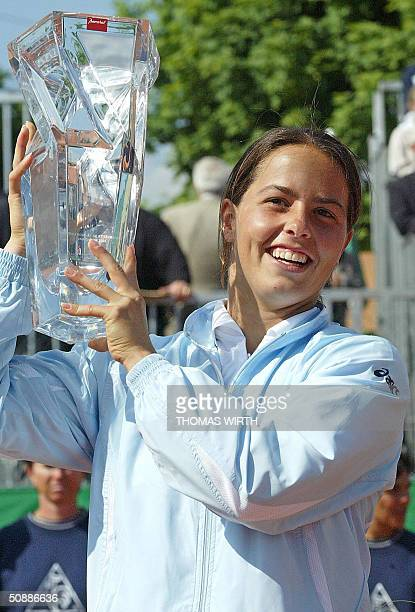 Luxembourg's Claudine Schaul holds up the Strasbourg's WTA International Tournament cup 22 May 2004 in Strasbourg eastern France after she defeated...