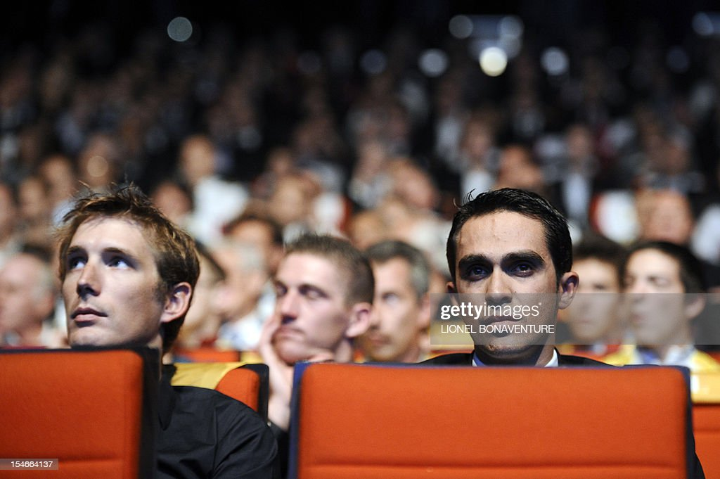 Luxembourg's cyclist Andy Schleck (L) and Spanish cyclist Alberto Contador attend the unveiling of the 2013 cycling classic Tour de France route on October 24, 2012 in Paris. The 100th edition of the Tour will take place from June 29 to July 21 and will start in Corsica for the first time in its history.